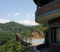 Вид на Аннапурну с территории отеля Rock garden