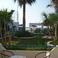 Вид с нашей террасы на бар и бассейн